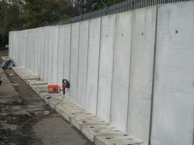 Concrete bolt down retaining wall jp concrete for Precast concrete basement walls cost
